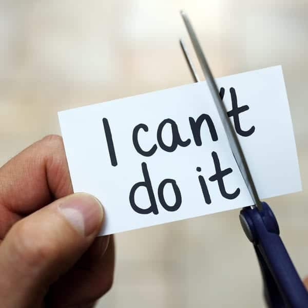 "Person cutting ""I can't do it"" note"