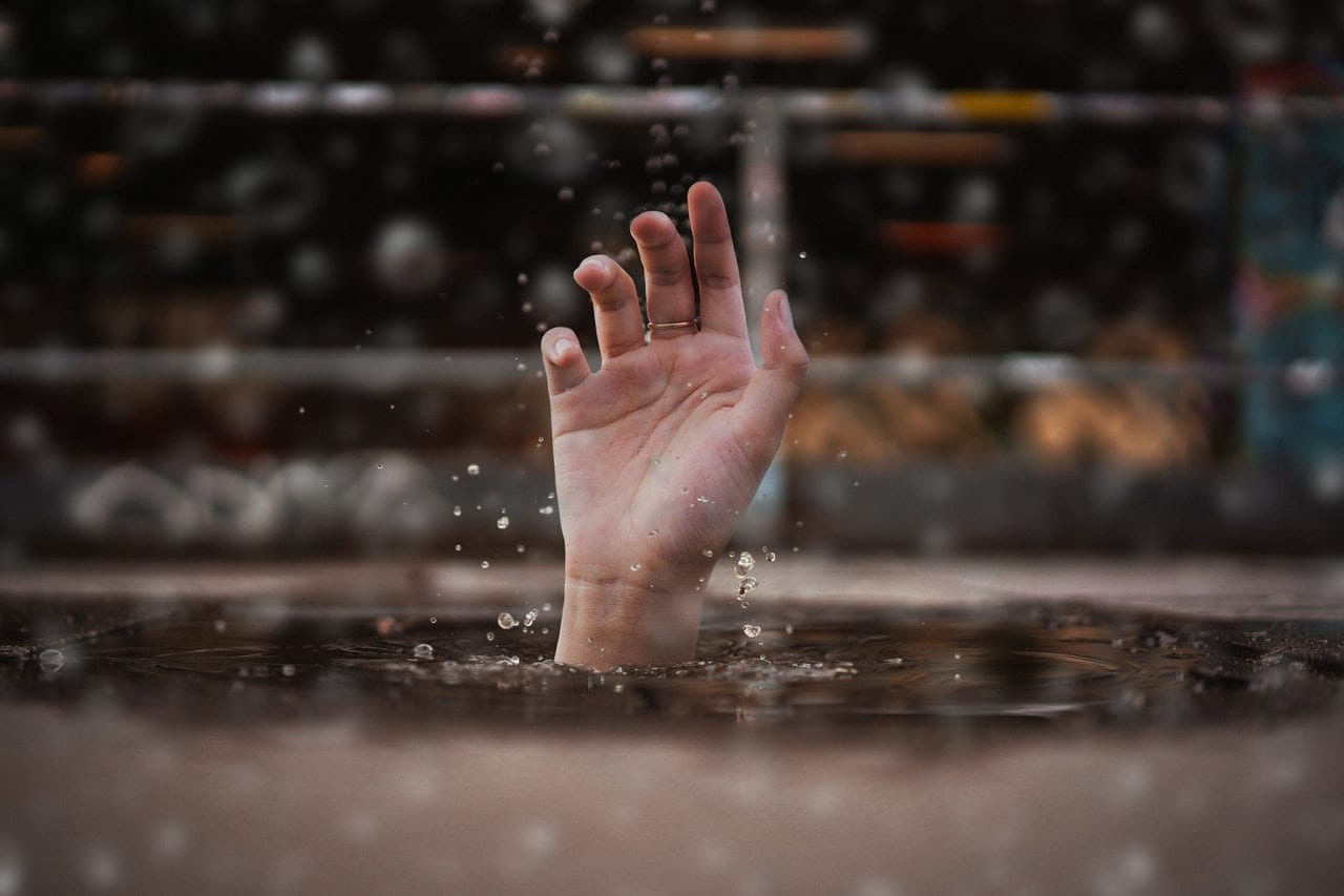 Hand just above the water